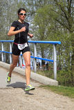 A contender, Jolanda Nell running the course Royalty Free Stock Image