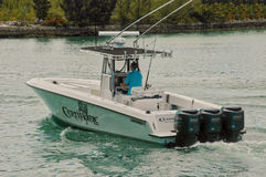 Contender 33 Sports-fish boat, Bahamas. A 33 foot sport-fisherman boat with triple 250 hp Yamaha outboard motors idling out of the marina. Freeport Bahamas stock photo