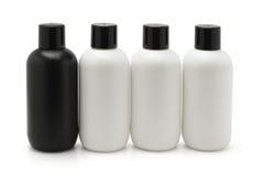 Conteneurs cosmétiques noirs et blancs Photos libres de droits