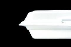 Contenitore bianco di schiuma di stirolo su fondo nero Immagini Stock Libere da Diritti