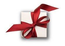 Contenitore di regalo bianco con l'arco rosso Fotografie Stock