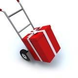 Contenitore di regalo in carrello di spinta Fotografia Stock