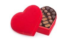 Contenitore di regalo che mangia il cioccolato Immagini Stock