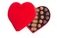 Contenitore di regalo che mangia il cioccolato Fotografie Stock
