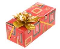Contenitore di regalo con il nastro dell'oro su bianco Immagini Stock Libere da Diritti