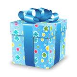 Contenitore di regalo con l'arco del nastro e fiocchi di neve variopinti per il Natale ed il buon anno di festa Immagini Stock Libere da Diritti