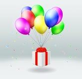 Contenitore di regalo con le mosche sui palloni Fotografia Stock