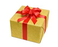 Contenitore di regalo dell'oro con l'arco rosso astuto Fotografia Stock