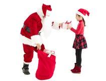 Contenitore di regalo di consegna del Babbo Natale al bambino Fotografie Stock Libere da Diritti