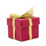 contenitore di regalo di natale con un arco del nastro dell'oro Fotografia Stock Libera da Diritti