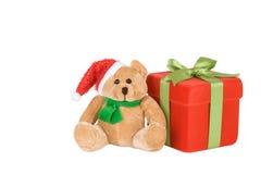Contenitore di regalo e orsacchiotto rossi della Santa Immagini Stock Libere da Diritti