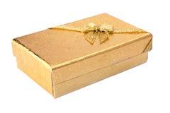 Contenitore di regalo ed arco dorati del nastro Fotografia Stock