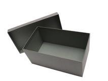 Contenitore di regalo grigio contro una priorità bassa bianca Fotografia Stock