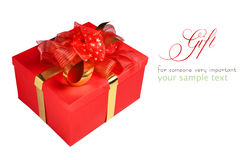 Contenitore di regalo rosso con l'arco Fotografia Stock