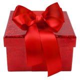 Contenitore di regalo rosso con l'arco del nastro Immagini Stock