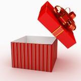 Contenitore di regalo sopra priorità bassa bianca Fotografie Stock Libere da Diritti