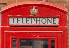 Contenitore rosso di telefono Fotografia Stock