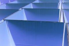 Contenitori blu astratti di cartone Immagini Stock