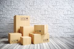 Contenitori commoventi di cartone nella nuova casa fotografie stock