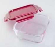 Contenitori di alimento sui precedenti contenitori di alimento di vetro sul Fotografia Stock