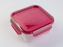 Contenitori di alimento sui precedenti contenitori di alimento di vetro sul Fotografie Stock Libere da Diritti