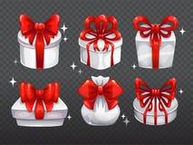 Contenitori di regalo bianchi con i grandi archi rossi Fotografia Stock