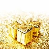 Contenitori di regalo dell'oro Fotografia Stock