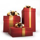 Contenitori di regalo rossi con il nastro e l'arco dell'oro Fotografie Stock Libere da Diritti