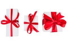 Contenitori di regalo su bianco Immagini Stock