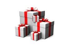 Contenitori di regalo su una priorità bassa bianca Fotografia Stock