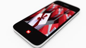 Contenitori di regalo sullo schermo del telefono Immagini Stock