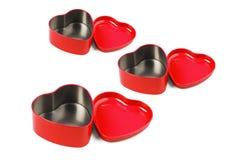Contenitori a forma di del metallo del cuore rosso Fotografia Stock