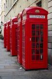 Contenitori rossi BRITANNICI di telefono Immagine Stock