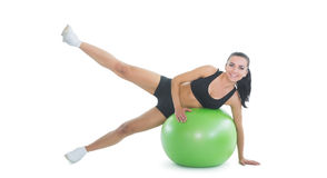 Content active woman doing an exercise on a green fitness ball Royalty Free Stock Photography