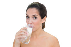 Content bare brunette drinking glass of water Royalty Free Stock Photography