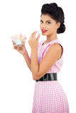 Content black hair model eating candies Stock Photo