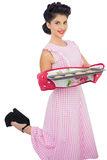 Content black hair model holding baking tray of cookies Stock Photography