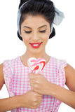 Content black hair model holding a heart shaped lollipop Stock Images