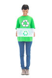 Content black haired ecologist holding a recycling box Stock Image