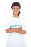 Content black haired volunteer posing with crossed arms Stock Image