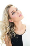 Content blonde model tilting her head Royalty Free Stock Photo
