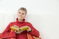 Content with book Stock Photos