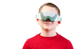 Content boy in red wears virtual reality glasses Stock Images