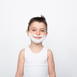 Content boy in shaving foam Royalty Free Stock Images