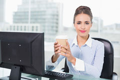 Content brunette businesswoman holding disposable cup Royalty Free Stock Photo