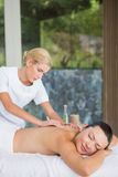 Content brunette getting a back massage Royalty Free Stock Photos