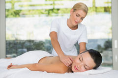 Content brunette getting a back massage Stock Photos
