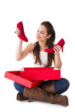 Content brunette holding red shoes Royalty Free Stock Photography