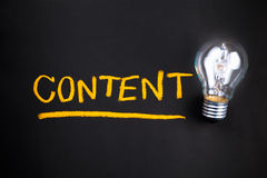Content bulb. Content topic with glowing light bulb royalty free stock photography