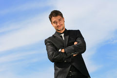 Content businessman. Man standing with his arms crossed Royalty Free Stock Photos